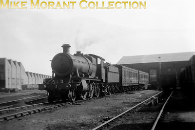 An interesting picture. The topic of interlopers on Southern metals comes up with monotonous regularity on the SEmG Yahoo message board and the same answers get trotted out every time. Here we see Churchward 4300 class mogul No. 6313 of 1921 vintage on the company of some pre-grouping, probably of LSWR origin, service stock at Fratton mpd on 12/9/49. According to my allocations source 6313, which had until recently been a Reading based engine, had by this time been transferred to Oxford mpd.
