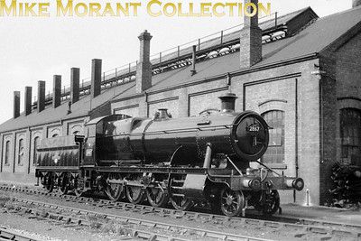 Ex-works at Swindon is GWR Churchward designed 2800 class 2-8-0 no. 2867. There's no legible shed plate but 2867 was a South wales based engine from the time that the second BR emblem was implemented and it was withdrawn in July 1963 whilst allocated to 86A Newport Ebbw Junction.
