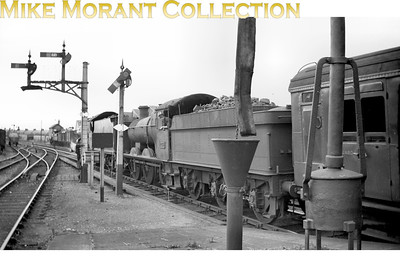 This negative was sent to me by mistake and I never did get the original purchase which was a portrait of West Clare Railway no. 10. However, I was given this shot as part of the compensation and what an interesting one it is. After much shuffling around of the digital image amongst GWR aficionados two pundits positively identified the location as Wrexham looking towards the North signal box which is visible in the background. The leading coach is a Maunsell 3rd brake by the looks of it and the motive power is Collett 2251 class 0-6-0 2235 piloted by an unidentifiable Castle class 4-6-0.  2235 would have been a Shrewsbury allocated engine when this shot was taken and so that must have been before a move to Brecon mpd in August 1954. The train is almost certainly a through working from either Bournemouth or Dover to Birkenhead.