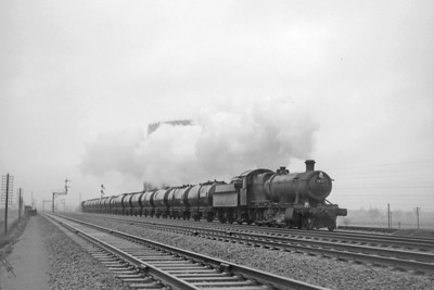 Collett 2800 class 2-8-0 no. 3823 with a train comprising oil or chemicals tank wagons is shown here on the Up Relief line just to the east of Didcot station in late 1964 or early 1965. [Mike Morant collection]