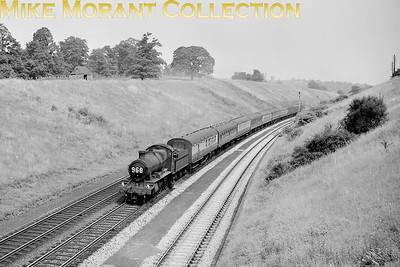 Personally I always hated those running numbers on the smokebox doors of GWR locos as it makes loco identification well nigh impossible. This is a Churchward mogul depicted near Hatton on a brightly lit day in August 1959 and sporting reporting No. 968 which, I've been informed, was the 09:10 Margate - Wolverhampton. [Mike Morant collection]