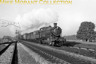 An evocative shot of a classic Swindon design in the form of an unidentifiable 2800 class 2-8-0 at Woodborough. This would have been taken near to the end of WR steam operations as the smokebox number plate has been removed.