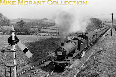 RCTS / Plymouth Railway Circle: The Cornubian 3/5/64 Collett 2800 class 2-8-0 no. 2887 hauled this special from Exeter St. David's to Plymouth and is seen here at Tigley on the ascent of Rattery bank. The Cornish part of the tour from Plymouth to Penzance and back was hauled by Bulleid original pacific no. 34002 Salisbury. 2887 then did the honours by returning the participants to Exeter. 2887 was a Taunton allocated engine at this time but was withdrawn in the month following this outing. [Mike Morant collection]