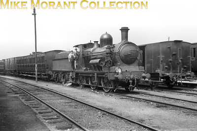 War Department engine no. 120 was originally GWR 2441, works no. 1371, built in 1893 at Swindon. She came to France in January 1940 and was allocated to the Northern region of the SNCF. This region never applied French numbers to its WD locomotives. From 1945 to 1947 she was allocated to the shed at Fives, a suburb of Lille whilst close examination of another negative elicits the fact that it was taken at the carriage storage facility at Lezennes about 3 miles further SE from her home shed. No. 120 was one of fourteen of this class sold to China in 1947, the year this picture was taken.