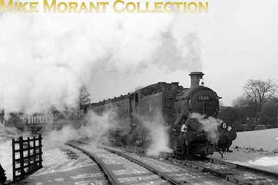 Hawksworth 0-6-0PT no. 1500 crosses the Old Oak flyover with its customary ecs during the bitter and snow laden January 1963. [A. E. 'Dusty' Durrant / Mike Morant collection]