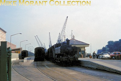A rather grainy and under exposed Ektachrome slide showing Weymouth Quay with a battered GWR 5700 class 0-6-0 pannier tank, no. 3759, ready to take thge next Up boat train to Waterloo along the Quay Tramway. 3759 was a Weymouth allocated engine from July 1959 until August 1963. [Mke Morant collection]