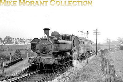 Collett 5700 class 0-6-0PT no 3794 pauses at Morebath Junction Halt on 29/5/63. [Mike Morant collection]