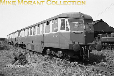 GWR Collett era diesel railcar no. W21W stored at Kidderminster shed with the pannier tank standing on the inspection pit in front of the shed. The negative isn't dated but all of this type were withdrawn between 1960 and 1962. [Mike Morant collection]