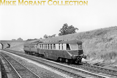 """GWR Collett diesel powered railcar no. 26 with trailer in charge of a Stratford-Leamington local descending Hatton Bank. The bridge is probably the one about a mile south of Hatton station. The line in the foreground is the Down (but """"up the bank"""") goods loop. [Mike Morant collection]"""