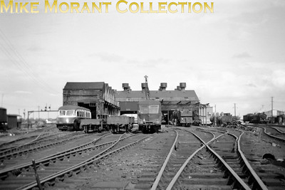 """Depicted at Southall mpd are two variants of the Collett railcars with the later design parcels car no. W34 on the right and the passenger carrying version of his first design, probably """"flying banana"""" no. W13, on the left. The bonus is a rather nice panoramic shot of the shed yard."""