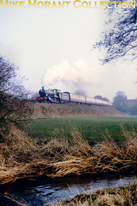 The West Somerset Railway's S&D Gala weekend on Sunday, March 10th 1996 was supposed to have BR Standard pacific no. 70000 Britannia as the star attraction but she failed before turning a wheel in service. The replacement on this occasion is Collett Manor class 4-6-0 no. 7819 Hinton Manor depicted here at Castle Hill.