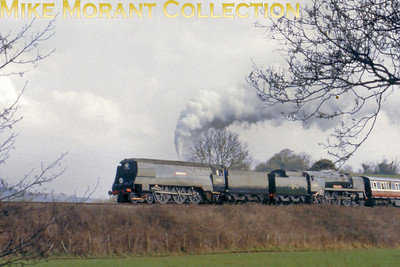 The West Somerset Railway's S&D Gala weekend on Sunday, March 10th 1996 sees preserved Bulleid pacifics 34105 Swanage and 34039 Boscastle working back-to-back on a Pines Express at Castle Hill.