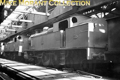 Vintage Irish Railways - Northern Ireland - UTAEx-BCDR 4-6-4T's nos. 225 & 226 stored inside Belfast's Queen's Quay shed on 25/4/54.