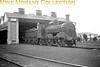 <center><u>Vintage Irish Republic Railways - Steam in Eire - 1954</u><br>Ex-GS&WR J15 0-6-0 no. 242 parked outside Portlaoise shed on 13/9/54.<center>
