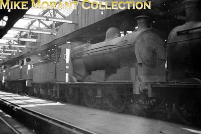 Vintage Irish Railways - Northern Ireland - UTAEx-BCDR 0-6-0 no. 10 stored inside Belfast's Queen's Quay shed on 25/4/54.