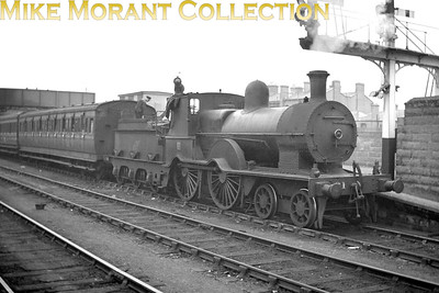 There were fifteen members of this delightful D14 class of 4-4-0's attributed to Aspinall and built by the GSWR at Inchicore works between 1885 and 1895. No. 61 was built in 1891 and modified in 1935 with this larger boiler and Belpaire firebox. Depicted here in charge of a southbound express at Bray station, no. 61 was one of the first two of the class to be withdrawn in 1955. [Mike Morant collection]