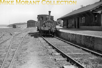 GSWR no. 90, an 0-6-0T of 1875 vintage, at Courtmacsherry station in 1953. The loco's history is an odd one as it started out as a combined loco and carriage with the 0-6-4T wheel arrangement when it was delivered to the Careisland Railway. It was subsequently rebuilt in 1915 to become one of the three J30 class. No. 99 of that class was withdrawn in 1930 but nos. 90 and 100 survived until 1959 utilised in the declining years shunting Cork Quays and and Albert Quay station. [Mike Morant collection]