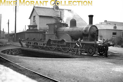 There were fifteen members of this delightful D14 class of 4-4-0's attributed to Aspinall and built ny the GSWR at Inchicore works between 1885 and 1895. No. 63  was built in 1891 and is depicted here being turned at Bray mpd. No. 63 was one of the first two of the class to be withdrawn in 1955. [Mike Morant collection]