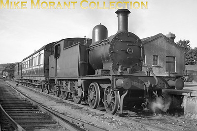Robinson designed and Kitson built for the WLWR in 1896, CIE C5 class 4-4-2T no. 269 continued in service until 1957 thereby becoming the last Robinson designed loco in service in Ireland. This delightful portrait was taken at Skibbereen and the train is is facing towards Cork. [Mike Morant collection]