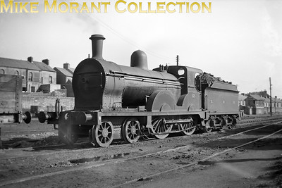 Vintage Irish Railways - Northern Ireland - GNRGNR(I) PP class 4-4-0 no. 12 at Derry shed on 4/9/53.