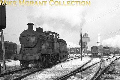 Vintage Irish Railways - Northern Ireland - UTAReboilered Heavy Goods 'V1' class 0-6-0 No. 13 was a Derby product dating from 1923. I'm assuming that this is a snow covered York Road, Belfast shed shot. Note the glimpse of the recently restored U2 4-4-0 No. 74 in the background which, together with Joe Cassells' observation that the shed is in the process of being converted into a diesel depot, should help in the pinpointing of a date which must, in any case, be the late 1950's.From an original Bob O'Sullivan negative. [Mike Morant collection]