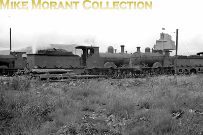 Vintage Irish Railways - Northern Ireland - LMS - NCCFormer Belfast and Northern Counties Railway 2-4-0's started life as identical members of the Beyer Peacock built 'F' class but  ended up with distinct differences in appearance. In this pre-1939 shot taken at York Road No. 23, nearer the camera, was still  much the same as when she had entered service in 1885 but No. 46, delivered in 1880, had been substantially rebuilt in 1928 to become the sole 'F1' class engine. No. 23 was withdrawn in 1941 whilst No. 46 had long departed the scene in 1938.From an original Bob O'Sullivan negative. [Mike Morant collection]