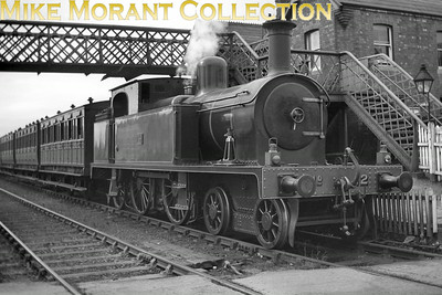 Vintage Irish Railways - Northern Ireland - BCDRBelfast and County Down Railway No.12 was one of the 'Small' Beyer Peacock built 4-4-2T's and is depicted in lined green livery at Bloomfield.This is a Bob O'Sullivan negative and my thanks go to Robert Gardiner for the location. [Mike Morant collection]