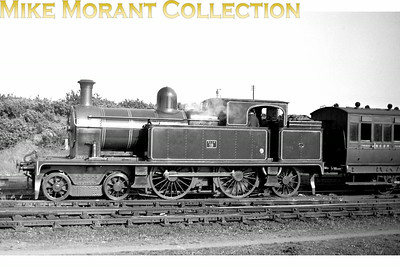 Vintage Irish Railways - Northern Ireland - BCDRBelfast and County Down Railway No.18 was one of the 'Small' Beyer Peacock built 4-4-2T's and is depicted in lined green livery at Newcastle.This is a Bob O'Sullivan negative and my thanks go to Robert Gardiner for the location. [Mike Morant collection]