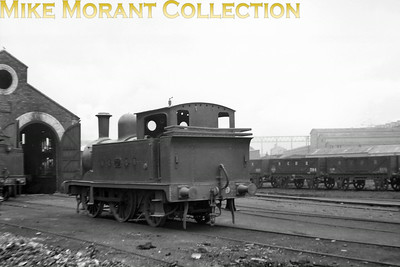 """Vintage Irish Railways - Northern Ireland - BCDRBelfast and County Down Railway 0-4-2T was rebuilt from an 0-4-2 in 1900 and ended her 'working' life in 1949 having been renumbered as 28 at some time in the mid-1940's. This less than sharp view was probably taken just before WW"""" and what I think is Queens Quay. [Mike Morant collection]"""