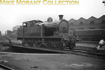 Vintage Irish Railways - Northern Ireland - BCDRIntroduced as a Beyer Peacock built class in 1924 this is Belfast and County Down Railway 'Large' Atlantic tank No. 16 on the turntable at Queen's Quay mpd.This is a Bob O'Sullivan negative and my thanks go to Robert Gardiner for the location. [Mike Morant collection]
