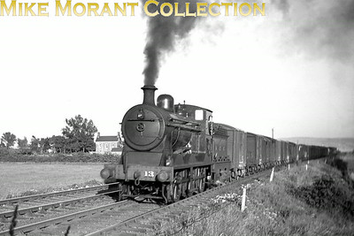 Vintage Irish Railways - Northern Ireland - LMS - NCCHeavy Goods 'V' class 0-6-0 No. 13 was a Derby product dating from 1923. I don't know the location but Paul McCann's suggested location for the double-headed 4-4-0's as probably being in the Monkstown area is very likely applicable here also.From an original Bob O'Sullivan negative. [Mike Morant collection]