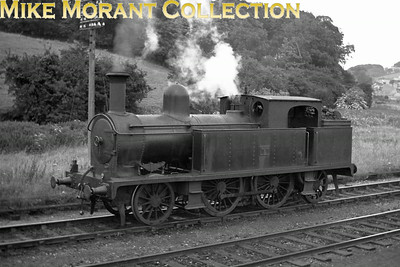 Vintage Irish Railways - Northern Ireland - BCDRBelfast and County Down Railway No. 5 was one of two Beyer Peacock 2-4-2T's - the other was No. 7 - delivered to the BCDR in 1896/7 but she and her sister were displaced from main line service with the advent of the Atlantic tanks. This image from a Bob O'Sullivan negative depicts No. 5 on an unknown date at Downpatrick. Both loco's were withdrawn from UTA stock in 1949.Location and other background data supplied by Robert Gardiner. [Mike Morant collection]