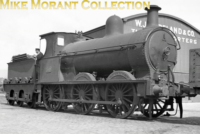 Vintage Irish Railways - Northern Ireland - LMS - NCCFormer Belfast and Northern Counties Railway 0-6-0 No. 30 was built by Beyer Peacock in 1897, entered service as a 'K' class but was rebuilt in 1922 to K1 specification. She remained in service only until 1938. Joe Cassells suggests that this is somewhere on the Belfast Harbour Commissioners' system which this engine would have shunted quite often whilst Andrew Waldron agrees with the location and says that  the loco is outside Rea and Co Timber importers on Whittla Street, possibly the Whittla Street curve, just inside the BHC dock lines.From an original Bob O'Sullivan negative. [Mike Morant collection]