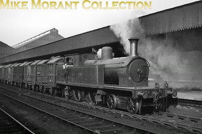 Vintage Irish Railways - Northern Ireland - BCDRBeyer peacock designed (and built) Atlantic tanks were the mainstay of the small Belfast and County Down Railway locomotive fleet and what a handsome bunch they were. Small 4-4-2T No. 3, photographed by the late Bob O'Sullivan at Queen's Quay station, was delivered to the BCDR in 1901 and survived until the mid-1950's in UTA ownership.Location and other data supplied by Robert Gardiner. [Mike Morant collection]