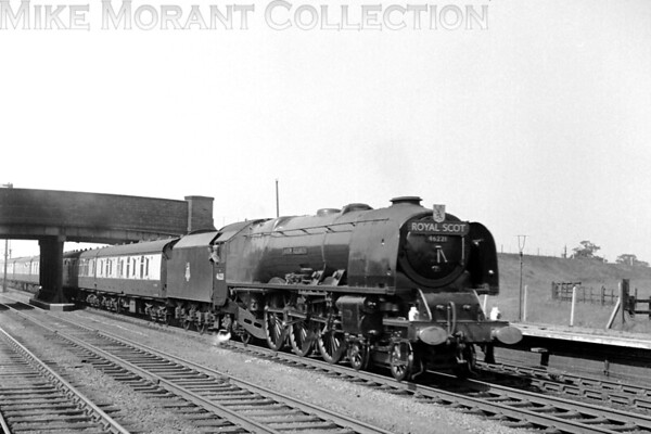 The Up 'Royal Scot' hauied by Stanier Coronation pacific -a genuine 'semi'- no. 46221 <i>Queen Elizabeth</i> on the up fast heading south towards Crewe at the closed Minshull Vernon station, Cheshire. This shot was taken before September 1952 when the sloped smokebox door was replaced by the circular type<br> [<i>Mike Morant collection</i>]