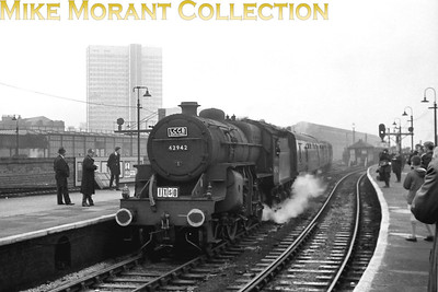 LCGB: Crab Commemorative Rail Tour 8/10/66 LMSR Hughes 'crab' 2-6-0 no. 42942 entering Manchester Victoria facing west towards Liverpool. In the background is Manchester Exchange the(second) eastern terminus of the Liverpool & Manchester Railway. 42942 was a Birkenhead allocated engine and would be withdrawn from service at the same shed in January 1967.