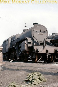 Forlorn looking Hughes 'Crab' 2-6-0 no. 42816 with wheels removed and no shed plate at Willesden shed in July 1964. 42816 was allocated to Gorton from 1959 until withdrawal in October 1964 and it's unlikely that it ever saw active service after this shot was taken. [Slide taken by Mike Morant]