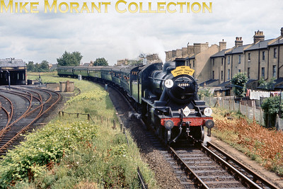 LCGB/REC: The Thames Valley Rail Tour 25/7/65 Ivatt 2MT 2-6-0 46509 is far from its home turf as it negotiates the curve from Crystal Palace to Norwood Junction whilst heading the'Thames Valley' railtour. The sad sight/site of the abandoned Norwood mpd is on the left.