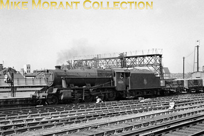 Stanier 8F's were quite a common sight at Clapham Junction but they seem to have been rarely photographed. Here we see no. 48219 passing southwards on the Windsor side of the station which suggests that the destination is Feltham yard. 48219 was a Cricklewood based angine from 10/52 thru' 11/56 and so that is probably the period when this shot was taken. Withdrawal for this engine came at Stockport Edgeley mpd in December 1966.