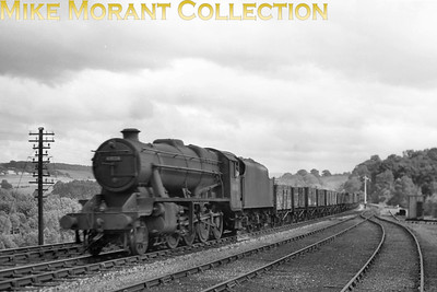 Stanier 8F 2-8-0 no. 48126 passes Baron Wood sidings on the S & C. [Mike Morant collection]