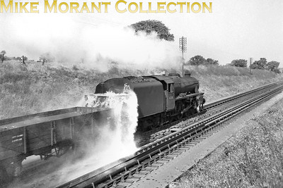 LMSR Stanier designed 'Black 5' 5MT 4-6-0 no. 45280 provided the photographer with a spectacular show as the tender overspills on a water as it forges northwards on Tamworth troughs. [Mike Morant collection]
