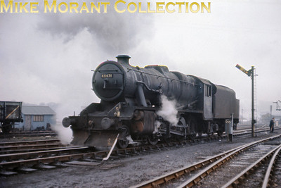 In truly decrepit condition, Stanier 8F 2-8-0 No. 48471 is seen on shed on the last day of steam at Buxton on 4/3/68.