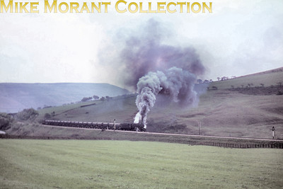 Stanier 8F 2-8-0 no. 48687 puts on a spectaciular show of clag on Norman's Bank (Edale) on April 30th, 1968.