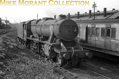 Careworn Stanier 8F 2-8-0 no. 48143, a Nottingham based loco, at Weymouth mpd on 24/4/65. [C. L. Caddy / Mike Morant collection]