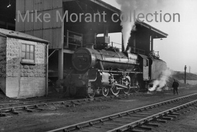 Stanier 'Black 5' 4-6-0 no. 44840, allocated to 2F Bescot at the time, is depicted here at the unlikely location of the Southern region's Hither Green mpd coaling stage on an unspecified date in 1964. [Mike Morant collection]