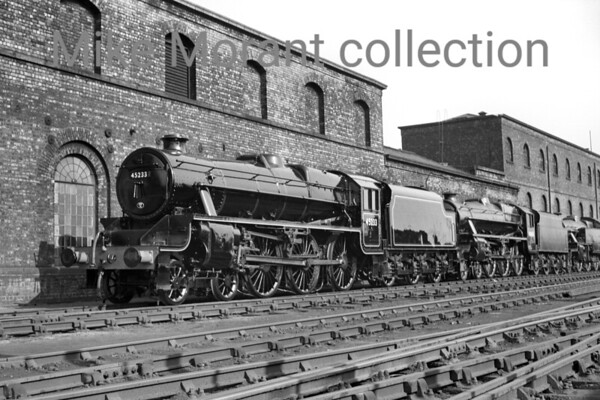 It's always a pleasure to see ex-paintshop locomotives no matter what the livery. In this undated view at Crewe Works we see Stanier 'Black 5' 4-6-0's nos. 45233 & 45054 with an unidentified 2-6-4T bringing up the rear. Of note is that the locos are fully lined and numbered but none has yet been adorned with a BR logo.