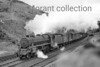 An unidentified Stanier 5MT 4-6-0 in charge of a fitted freight breasts Shap summit.<br> [<i>Mike Morant collection</i>]