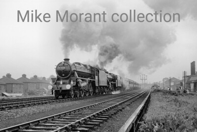 The Royal train with  H.M. The Queen on board departs from Chester at 1 p.m. bound for South Kirby on 11th July 1957 in the charge of Stanier Black 5' 4-6-0's nos. 45130 and 45247. Both engines were allocated to Mold Junction at the time. [Mike Morant collection]