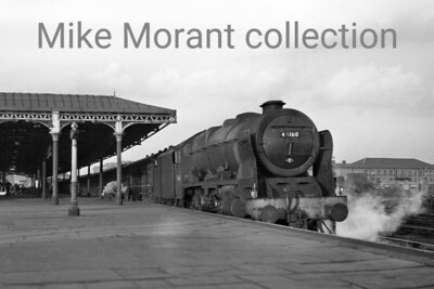 Former LMSR rebuilt 'Royal Scot' 4-6-0 no. 46160 Queen Victoria'a Rifleman at Burton-on-Trent station in May 1962. 46160 sports a 21A (Saltley) shed plate but would be moved to Carlisle (Upperby) in the following month. A further relocation to Kingmoor came a year thereafter followed by withdrawal in May 1965. [Mike Morant collection]