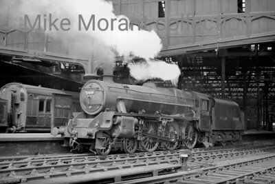 This picture of LMSR Stanier 'Black 5' no. 5018 is a superb portrait taken at Carlisle but the markings on the locomotive are something of a mystery. The smokebox door's number plate states that the number is 5018 but the cabside number is M5018 whilst the tender is bedecked with BRITISH RAILWAYS in full. My database tells me that its BR number, 45018, was applied in March 1950. Perhaps all that can be explained by an afianado of that sort of thing. The shed plate isn't quite legible but it is almost certainly 28A (Motherwell) which is where 5018 was allocated to between October 1947 and December 1949.